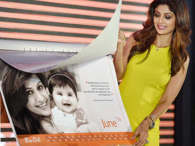 Shilpa Shetty releases a calendar during an event to celebrate Mother's Day in Mumbai. (PTI photo)