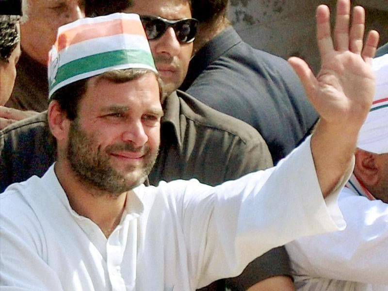 Congress vice-president Rahul Gandhi waves to his supporters during an election roadshow in Varanasi. (PTI photo)
