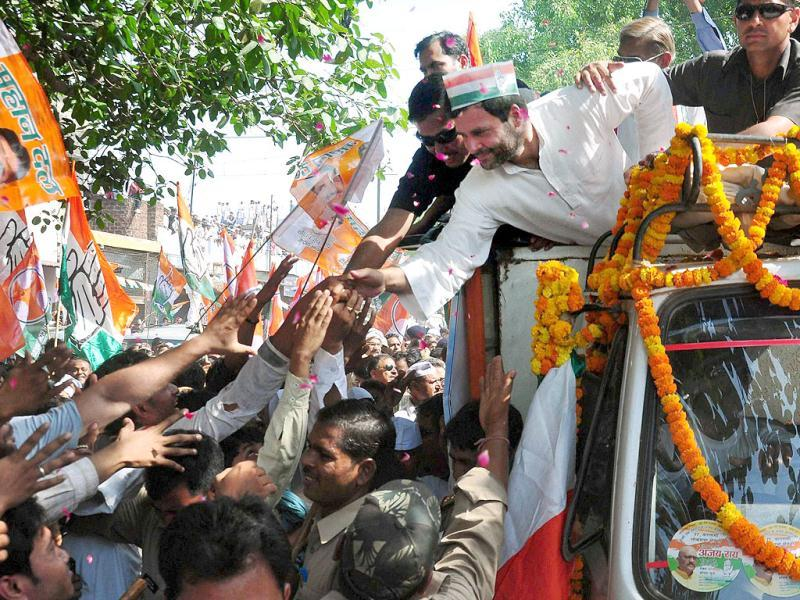 Congress vice-president Rahul Gandhi shakes hands with supporters during his road show in Varanasi. (PTI photo)