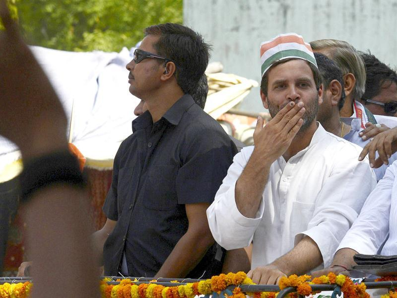 Congress vice-president Rahul Gandhi blows kisses to supporters from atop a truck as he makes his way through the streets of Varanasi. (AFP photo)