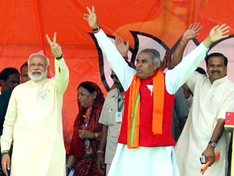 Jagdambika Pal with BJP's PM candidate Narendra Modi during an election campaign rally in Sidharth Nagar. (PTI Photo)