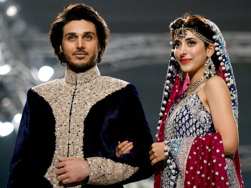 Models present the creations of Pakistani designer Zainab Chottani at the Bridal couture week in Karachi. (AFP)
