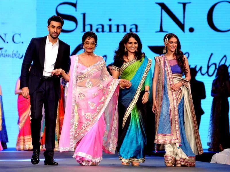 Veteran actor Sadhna walks the ramp with Ranbir Kapoor for designer Shaina NC as they attend a cancer fundraising event in Mumbai.(AFP)