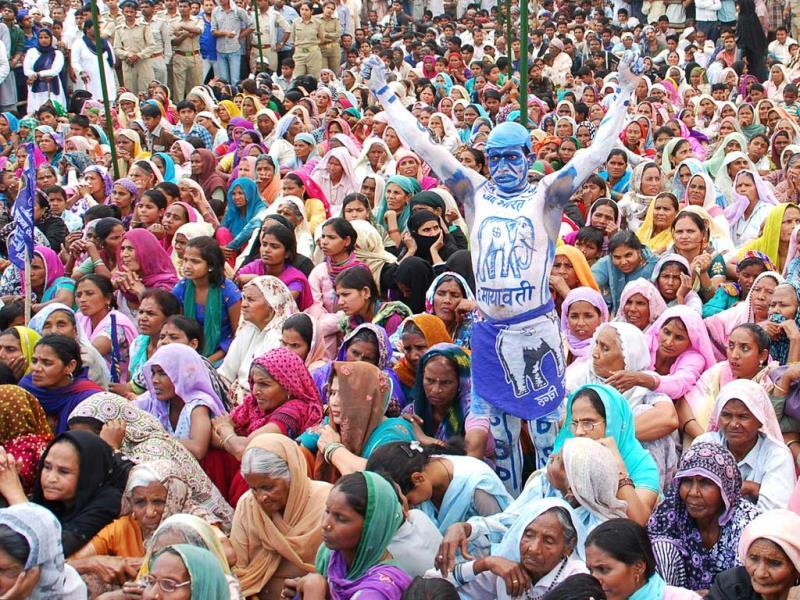 A BSP supporter, painted in the party's colours, stands in a sea of women during party chief Mayawati's election rally in Muzaffarnagar. (Chahat Ram/HT Photo)