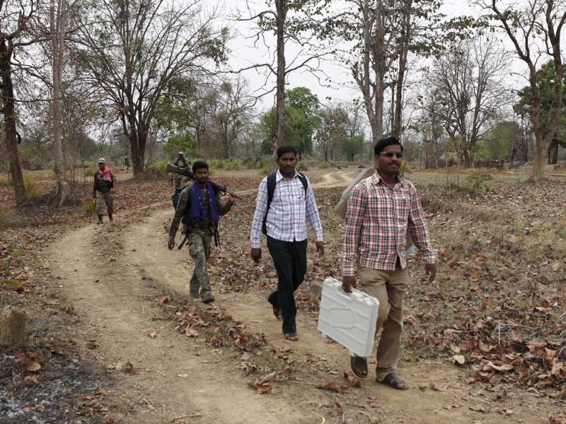 Election Commission officials were accompanied by security personal on their way to Kulbhatti village in Maoist-affected Gadchiroli in Maharashtra ahead of polling. (HT photo/Anshuman Poyrekar)