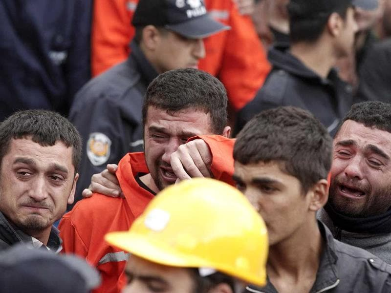 Relatives of miners who were killed or injured in a mine explosion react as rescuers work in Soma, a district in Turkey's western province of Manisa. (Reuters Photo)