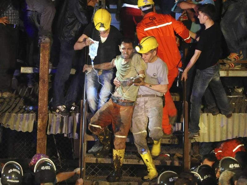 An injured miner is carried to an ambulance after being rescued from a coal mine he was trapped in, in Soma, a district in Turkey's western province of Manisa. (Reuters Photo)