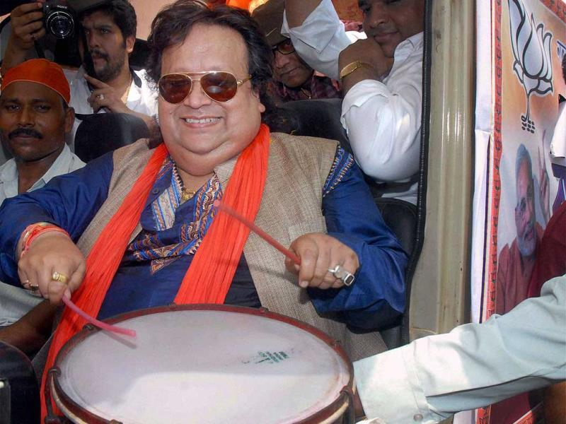 With singer and BJP candidate Bappi Lahiri in the fray, can drama be far behind? Watch Bappi da beat a drum during his election campaign at Nabagram in Hooghly district of West Bengal on Friday. (PTI Photo)