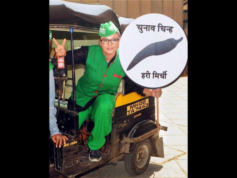 Actor Rakhi Sawant and Rashtriya Aam Party candidate found a quirky election symbol for her party - green chilli. Don't miss her matching attire! (PTI Photo)