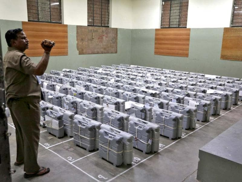 An official films electronic voting machines (EVM) inside a strongroom before the start of vote counting in Ahmedabad. (Reuters Photo)