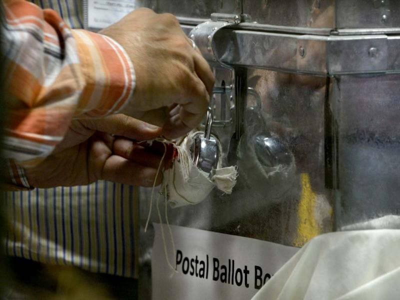 An Indian election commission officer opens a postal ballot box at a counting centre in New Delhi. (AFP Photo)