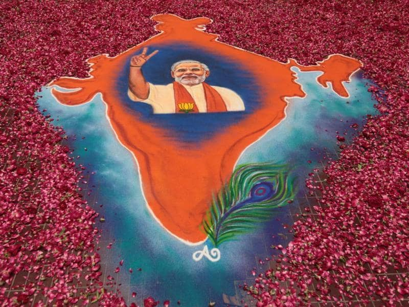 The vote tally completely 'floored' by Modi-led BJP is celebrated with a Rangoli at BJP Headquarters in Gujarat. (Vijayanand Gupta/ HT Photo)