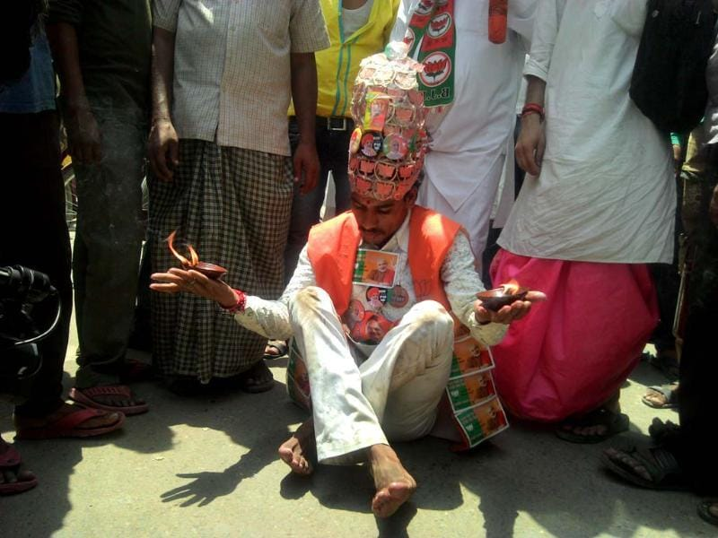 Nand Ram Gandharva has been promoting him barefoot ever since Modi's nomination for PM. (HT Photo)