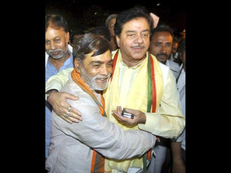 Ramkripal Yadav hugs Shatrughan Sinha as they celebrate BJP's victory in Lok Sabha elections in Patna. (PTI Photo)