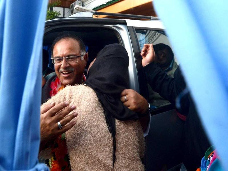 People's Democratic Party (PDP) candidate for Srinagar Tariq Hamid Karra hugs a supporter as he celebrates his election result in Srinagar. (AFP Photo)