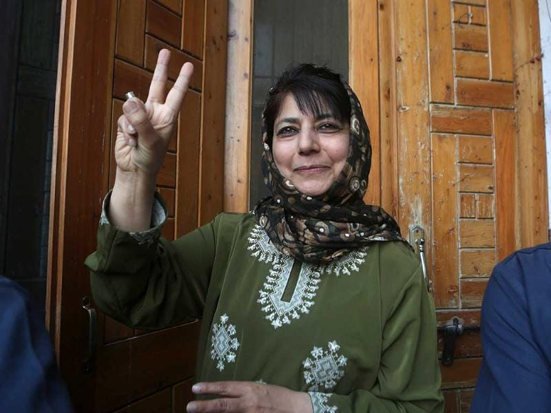 Peoples Democratic Party (PDP) president Mehbooba Mufti shows the victory sign after being declared winner for the parliamentary seat of Anantnag in Srinagar. (EPA Photo)