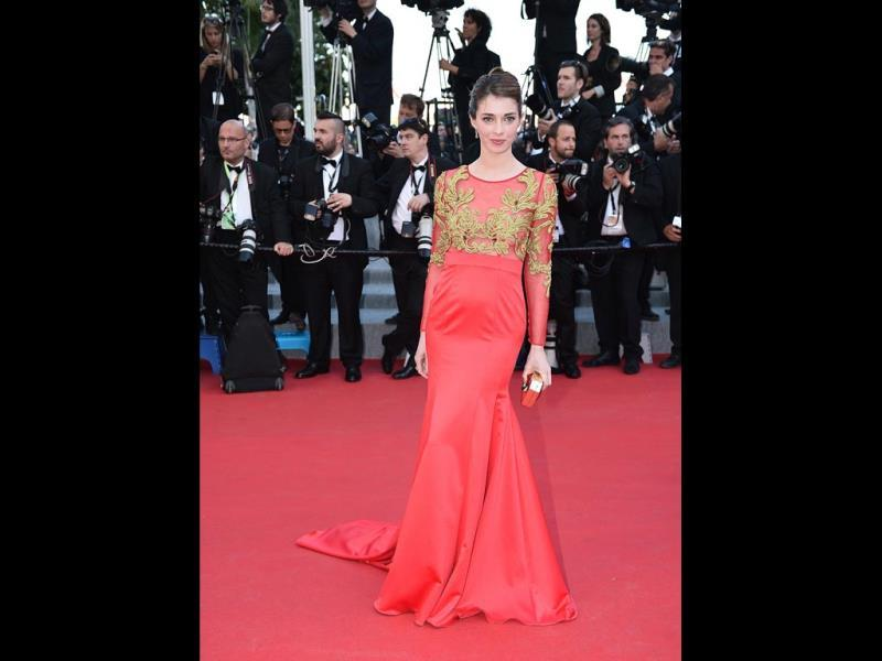 French actor Sarah Barzyk hit the red carpet wearing a silk gown by Christophe Guillarmé. (AFP Photo)