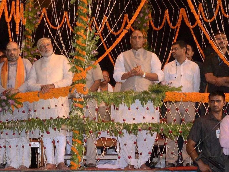BJP leader and PM-designate Narendra Modi with party President Rajnath Singh and Amit Shah attend Ganga Aarti in Varanasi. (PTI Photo)
