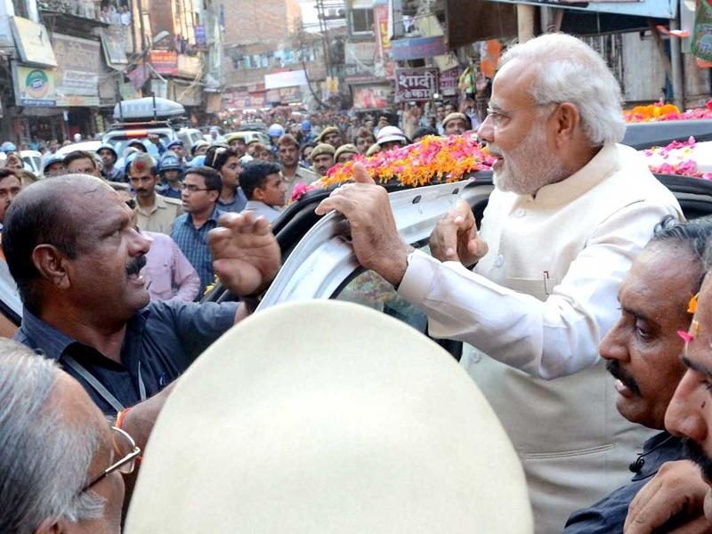 BJP leader and the next Prime Minister Narendra Modi arrives in Varanasi to attend Ganga Aarti, on Saturday. (PTI Photo)
