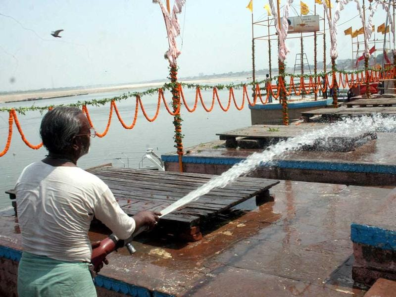 A man washing ghats at the bank of River Ganga where PM-designate Narendra Modi is to perform 'Ganga Aarti' in Varanasi. (PTI Photo)