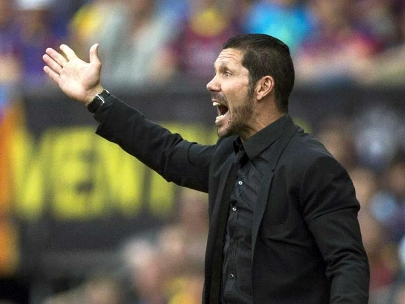 Atletico Madrid's head coach Diego Simeone reacts during their Spanish La Liga match against Barcelona at the Camp Nou stadium, in Barcelona. (EPA Photo)