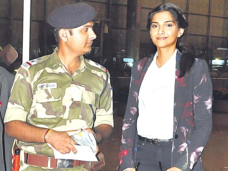 Sonam Kapoor stands with a security official at Mumbai airport befiore boarding her flight to Cannes. (Photo: Viral Bhayani)