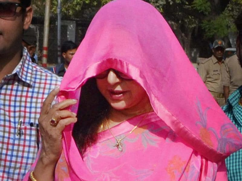 Too hot to handle? Hema Malini arrives at a counting station in Mathura. (PTI Photo)
