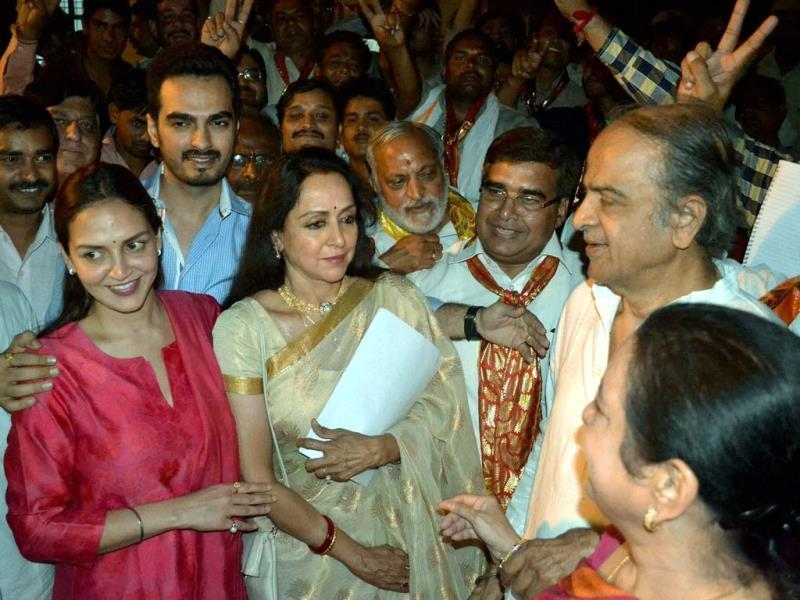 Bollywood actress and BJP candidate Hemamalini along with her daughter Esha Deol and son-in-law Bharat leaving from the counting station after getting certificate of win in Lok Sabha elections in Mathura on Friday. (PTI Photo)