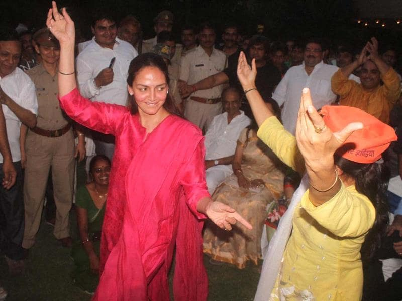 Bollywood actress Esha Deol dancing along with a BJP worker as she celebrates her mother Hemamalini's win in Lok Sabha elections, in Mathura on Friday. (PTI Photo)