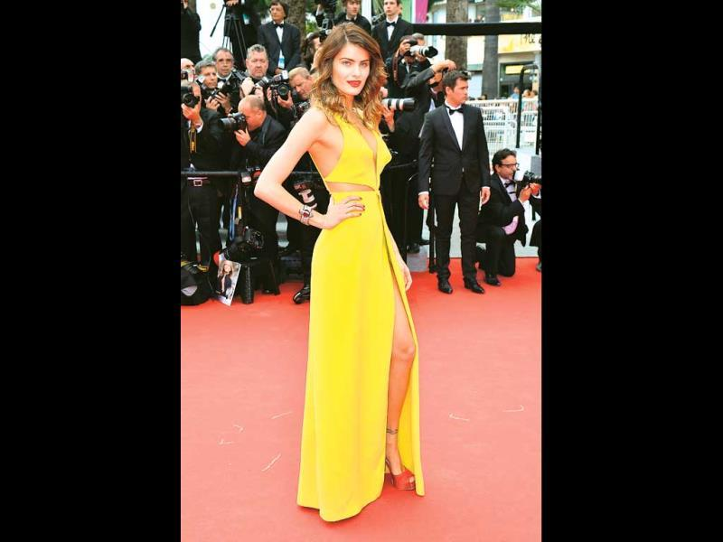 Models at Cannes are primarily present to add a wow factor to the red carpet, and trust Isabeli to deliver. Her cheery, yellow, risqué Tufi Duek gown ensured all eyes were on her. Special mention for the unusual styling with red shoes. (HT PHOTO)