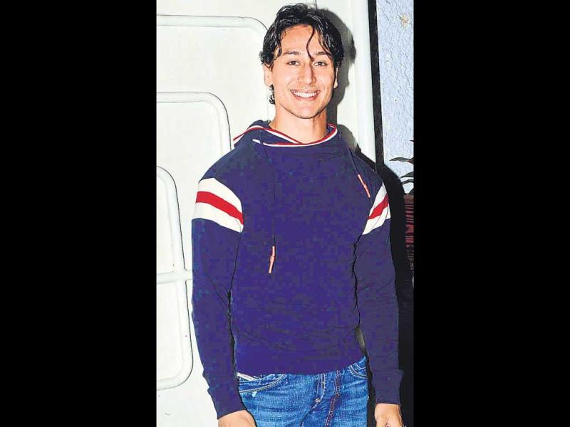 The bad: Tiger Shroff at a film screening OURTAKE: We can't imagine why Tiger would wear his tightest shirt in the searing heat. This one, with its straitjacket-like neck, is making us claustrophobic. (HT PHOTO)