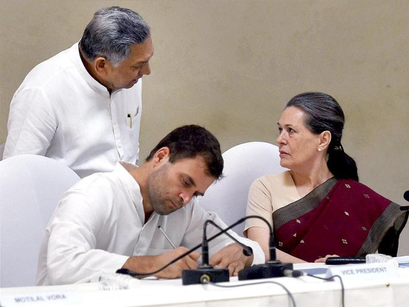 Congress president Sonia Gandhi with party vice president Rahul Gandhi and Janardhan Dwivedi at the CWC meeting at party headquarters in New Delhi. (PTI photo)