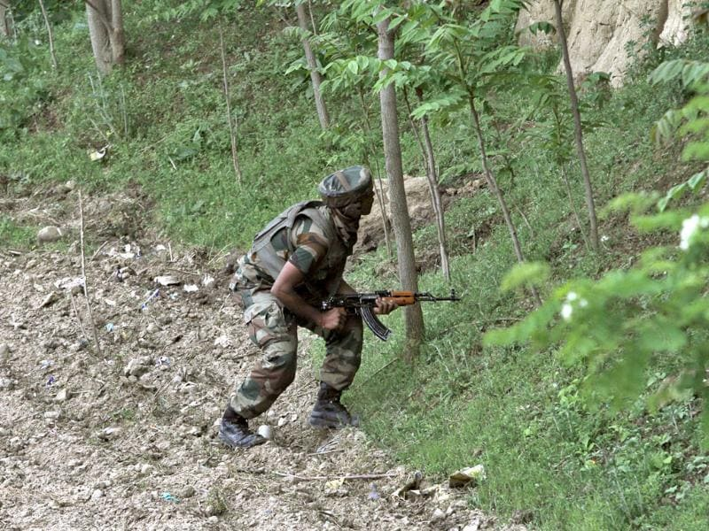 A soldier near the site of gun-battle at Chadoora town, about 25 kilometers south of Srinagar. (AP Photo)