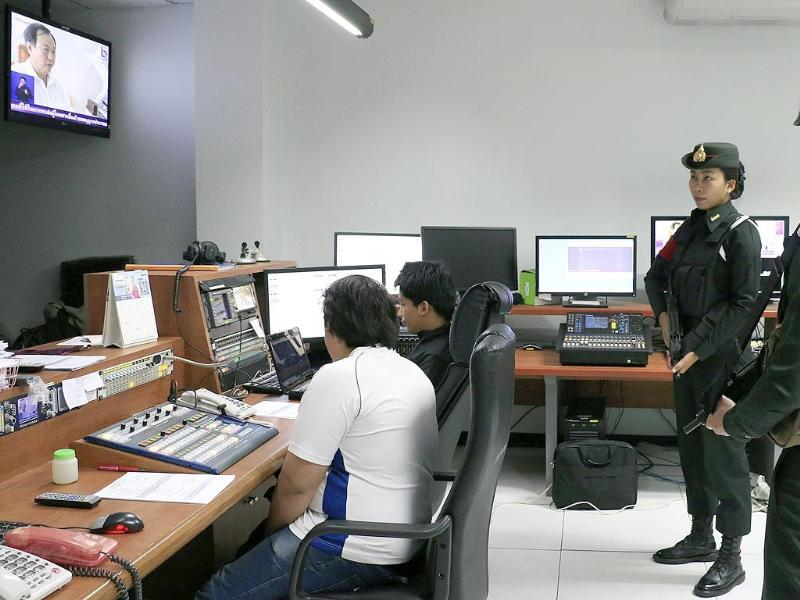 Thai soldiers inside the control room of the offices of the National Broadcasting Services of Thailand in Bangkok, Thailand. (EPA photo)