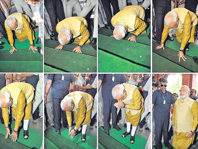 Modi bowed in respect at the steps of Parliament House as he arrived to attend a BJP parliamentary party meeting in New Delhi. (HT photo/Sonu Mehta)