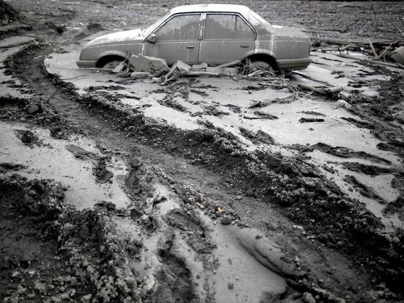 A flood-damaged Opel Astra is seen in Topcic Polje. (Reuters)