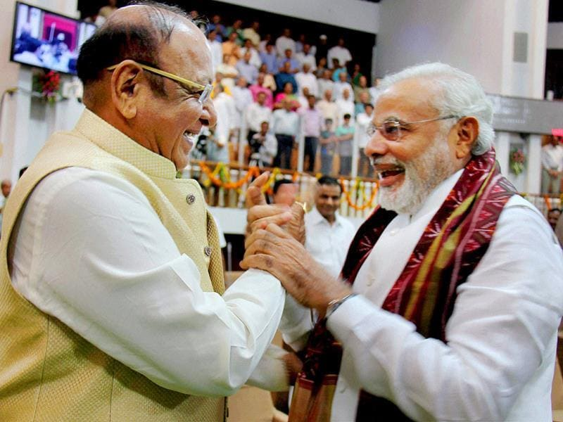 PM-designate Narendra Modi is greeted by senior Congress leader Shankersinh Vaghela during the special session of the state Assembly in Gandhinagar. (PTI Photo)