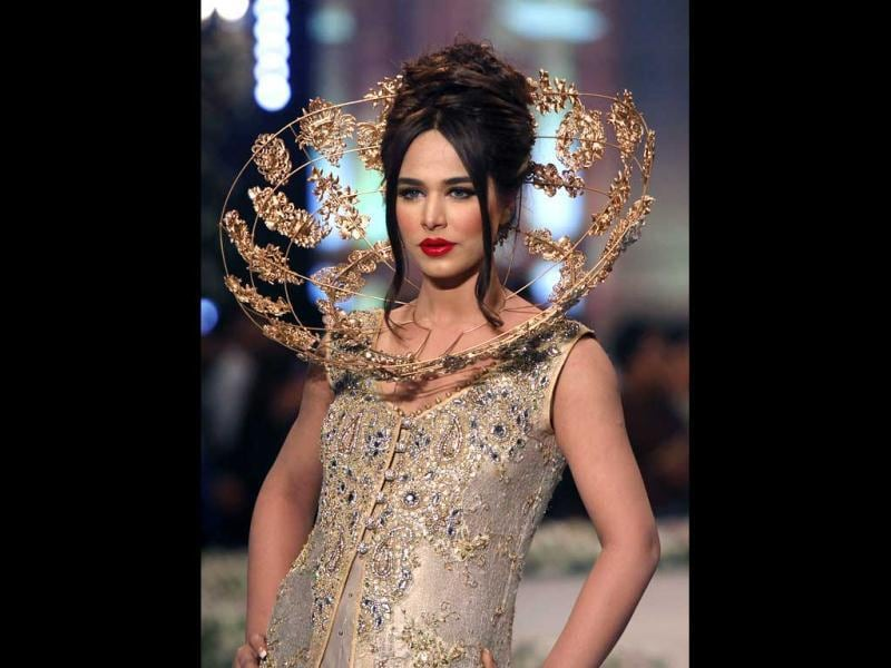 A model presents a creation by designer Tabassum Mughal on the third day of the Bridal Couture Week in Karachi. (AP Photo)