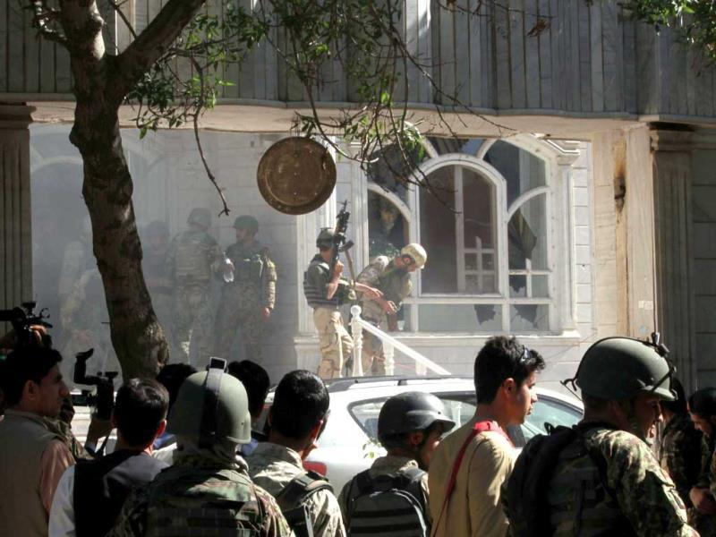 Afghan military personal take position at the scene of an attack on the Indian consulate in Herat. (AFP photo)