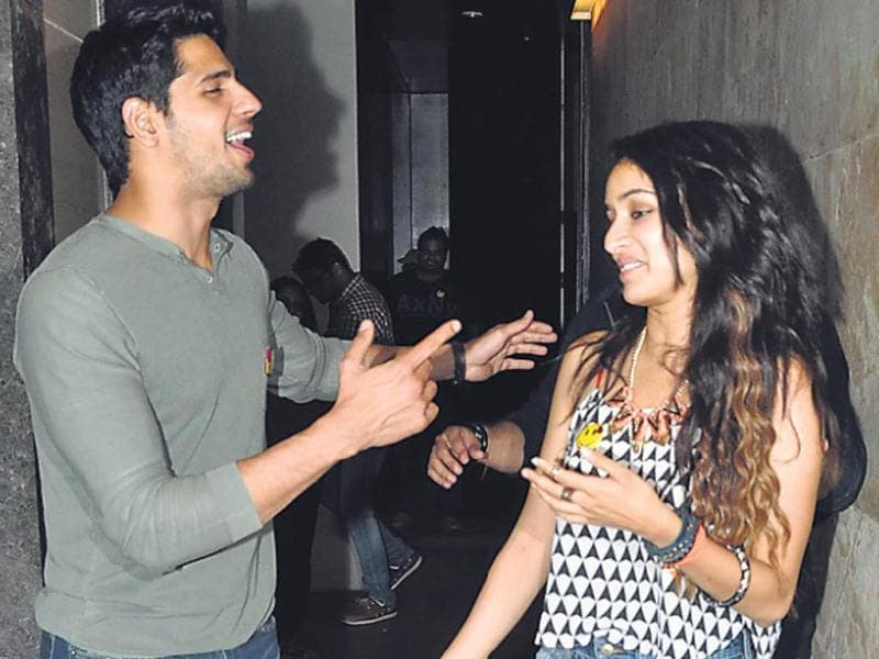Sidharth Malhotra bumped into Shraddha Kapoor at a movie event in Santacruz. (HT PHOTO)