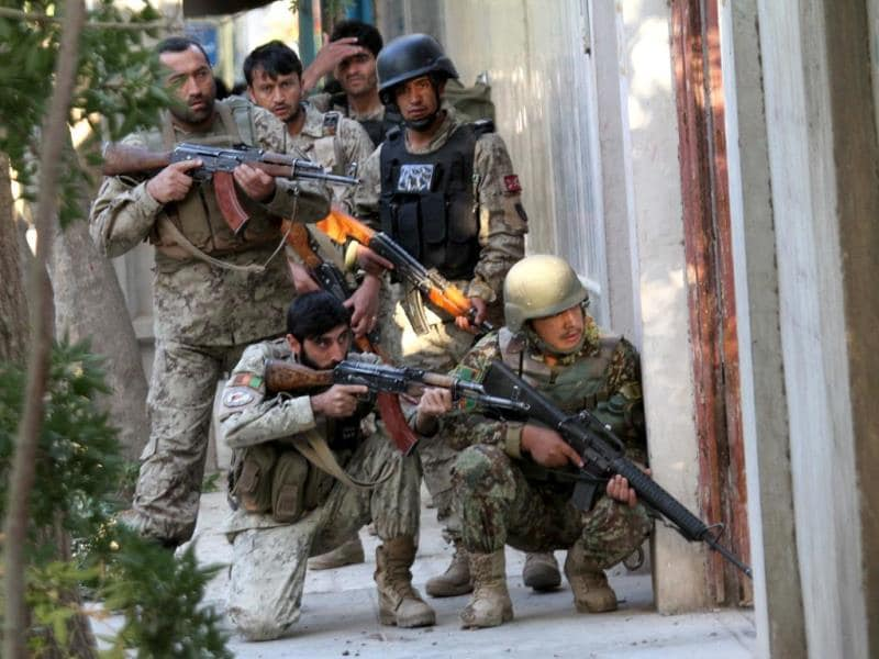 Afghan soldiers take position outside the building of the Indian consulate, during a gun battle with attackers in Herat, Afghanistan. (EPA photo)