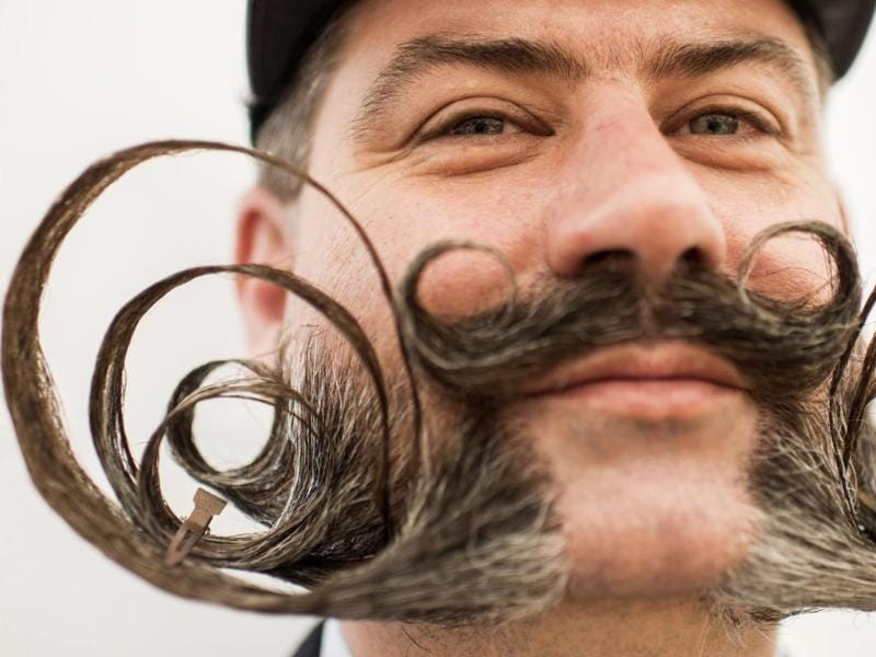 A competitor prepares for the European Beard and Moustache Championships in Urdorf, Switzerland (EPA Photo)