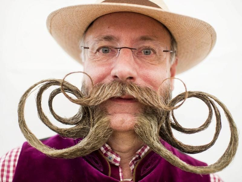Competitor Juergen poses for pictures during the European Beard and Moustache Championships in Urdorf, Switzerland (EPA Photo)