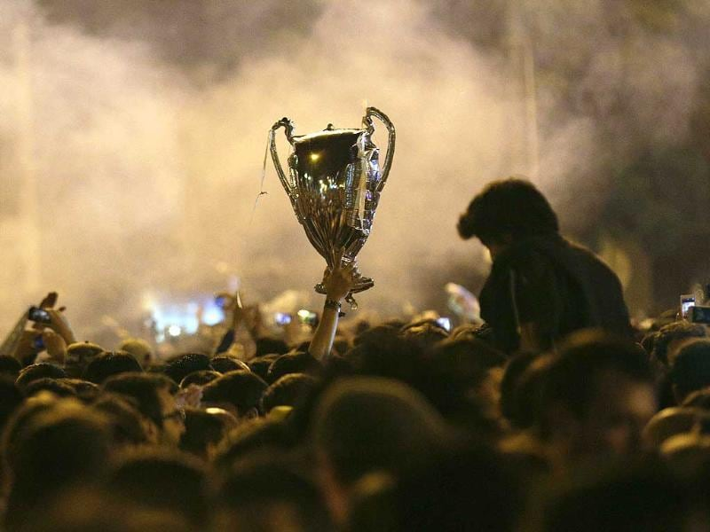 Real Madrid supporters celebrate their victory after their Champions League final match against Atletico Madrid, at a bar in Ronda, southern Spain. (Reuters Photo)