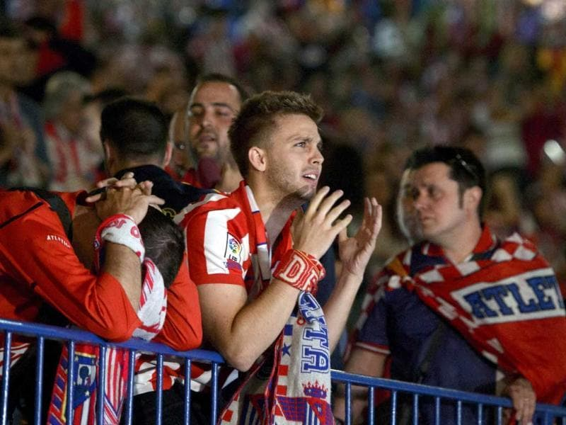 Atletico Madrid supporters gesture after their defeat in the Champions League final against Real Madrid in Madrid. (AFP Photo)