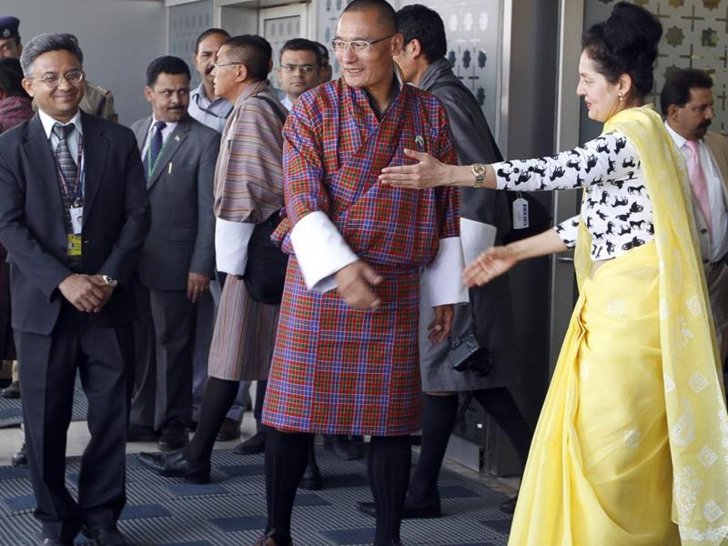 Prime Minister of Bhutan Lyonchen Tshering Tobgay being greeted by Ruchira Kamboj, senior official in the Ministry of External Affairs upon his arrival at IGI Airport to attend the swearing-in ceremony of PM-designate Narendra Modi in New Delhi. ( Sanjeev Verma/HT Photo)