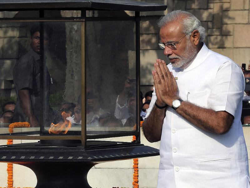 Narendra Modi pays tributes at Mahatma Gandhi's memorial ahead of his swearing-in as the 14th prime minister of India at the Rajghat. (EPA photo)
