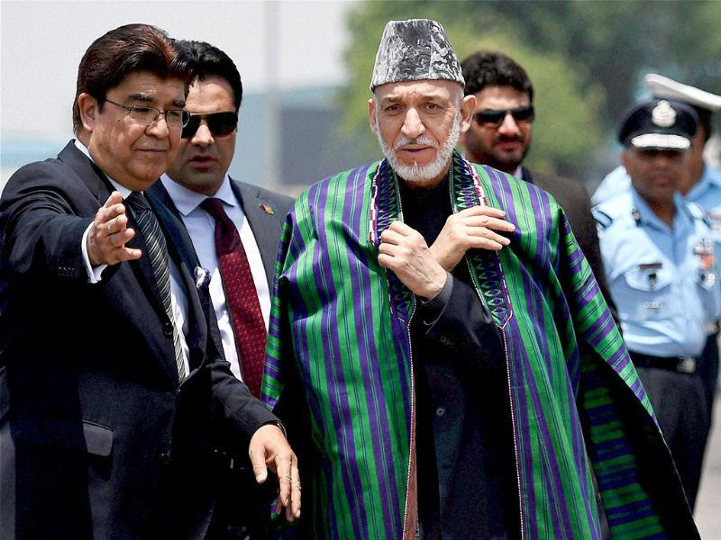 Afghanistan President Hamid Karzai arrives at AFS Palam to attend the swearing-in ceremony of Narendra Modi as Prime Minister in New Delhi on Monday. (PTI photo)