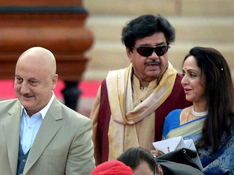 Actor-MPs Hema Malini and Shatrughan Sinha with actor Anupam Kher at the swearing-in ceremony of the NDA government at Rashtrapati Bhavan in New Delhi. (PTI Photo)