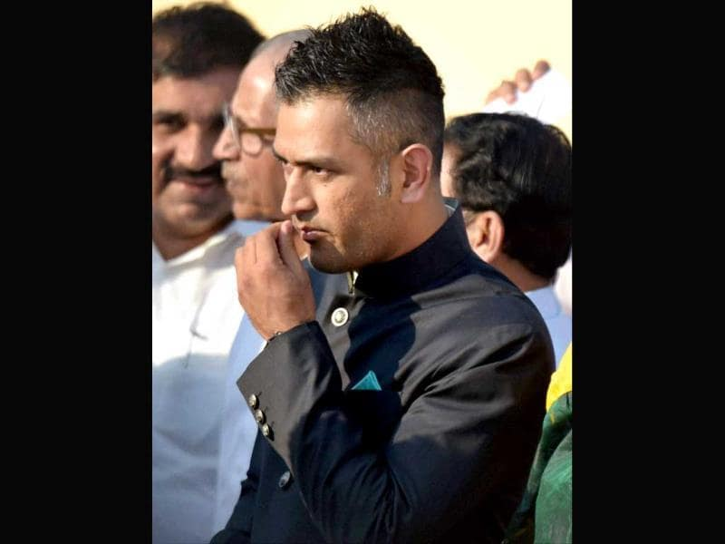 Indian cricket captain MS Dhoni at the swearing-in ceremony of the NDA government at Rashtrapati Bhavan in New Delhi. (PTI Photo)